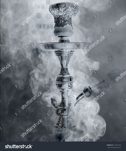 stock-photo-preparing-the-shisha-aka-nargile-or-hookah-at-a-restaurant-by-placing-the-charcoals-on-top-a-very-614341283.jpg